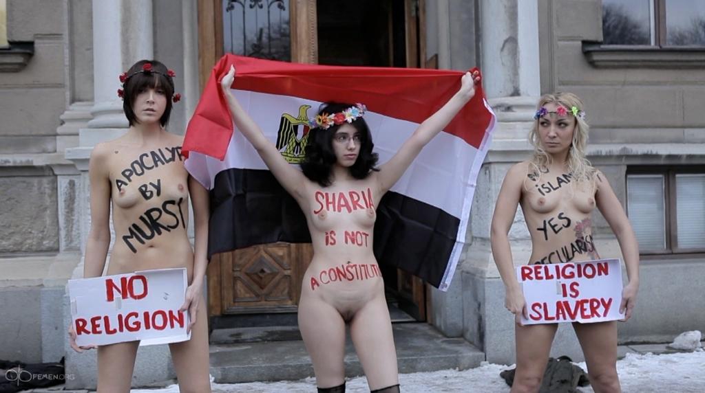 femen and aliaa elmahdy protest morsi in stock